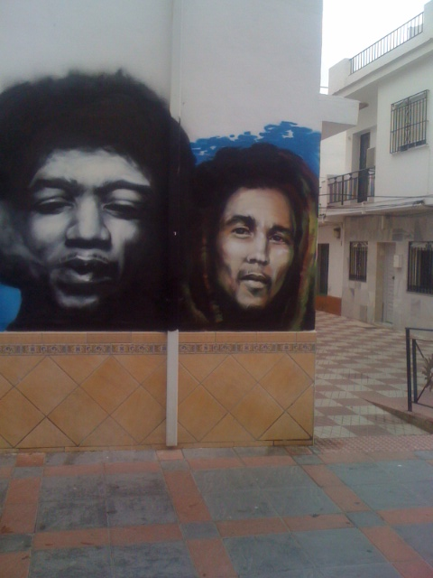A striking mural of Hendrix and Bob Marley
