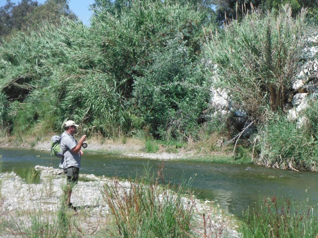 Simon plays his barbel close to the point where it was hooked