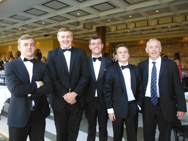These fellas have just graduated from school. Here we are again all dressed up at the graduation dinner last month.