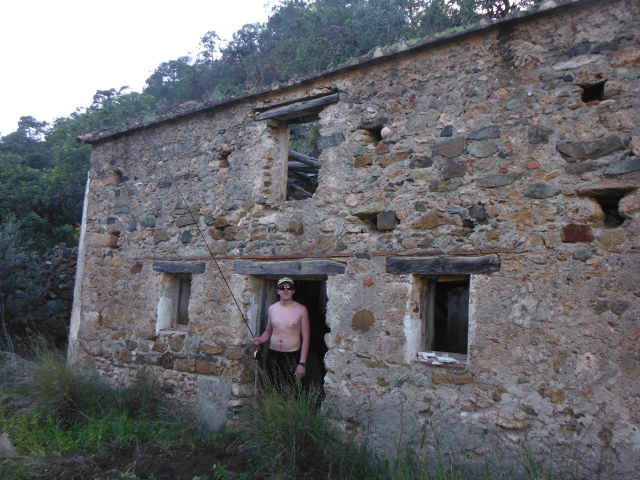 We pulled up to this abandoned stone building. Wild boar have been rooting around here recently and you can see the disturbed ground all around.