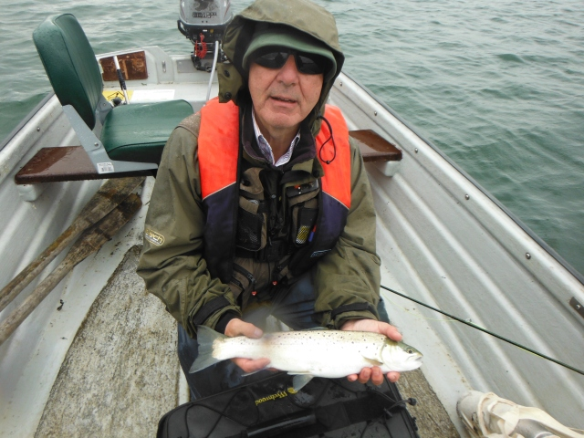 Harry with a handsome brown trout. It was pouring with rain when he caught it.