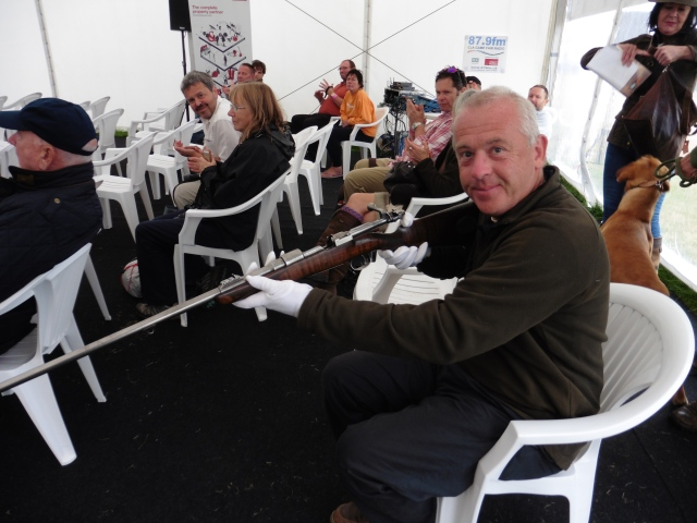 We were allowed to hold the famous rifle presented to Corbett in 1907 but had to put on special gloves to do so.