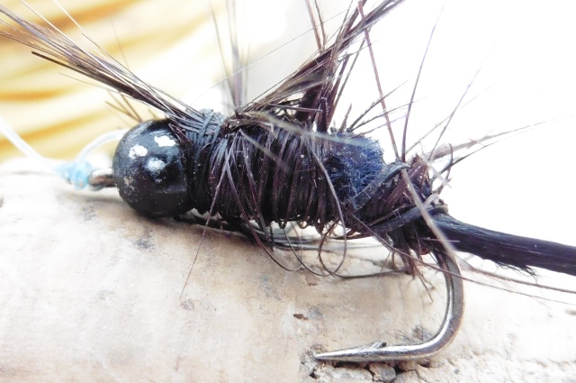 I´ve tied some ugly flies before but this one, further mutilated at the riverside is about as ugly as they come!